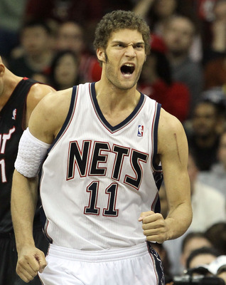 NEWARK, NJ - APRIL 03:  Brook Lopez #11 of the New Jersey Nets reacts against the Miami Heat at the Prudential Center on April 3, 2011 in Newark, New Jersey.The Heat defeated the Nets 108-94.NOTE TO USER: User expressly acknowledges and agrees that, by do