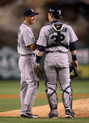 ANAHEIM, CA - APRIL 24: Pitcher Erik Bedard #45and catcher Rob Johnson #d32 of the Seattle Mariners talk on the mound in the game against the Los Angeles Angels of Anaheim on April 24, 2009 at Angel Stadium in Anaheim, California.  The Mariners won 8-3.