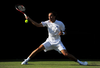 LONDON, ENGLAND - JUNE 21:  Aleksandr Dolgopolov of Ukraine returns a shot during his first round match on Day Two of the Wimbledon Lawn Tennis Championships at the All England Lawn Tennis and Croquet Club on June 21, 2011 in London, England.  (Photo by M