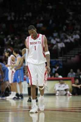 Tracy-mcgrady-hanging-head-zuma-20071220_zaf_e26_054-393x590_display_image