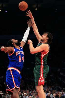 NEW YORK, NY - FEBRUARY 23:  Andrew Bogut #6 of the Milwaukee Bucks shoots the ball over Ronny Turiaf #14 of the New York Knicks at Madison Square Garden on February 23, 2011 in New York City. NOTE TO USER: User expressly acknowledges and agrees that, by