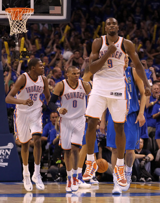 OKLAHOMA CITY, OK - MAY 23:  Serge Ibaka #9 of the Oklahoma City Thunder reacts in the fourth quarter while taking on the Dallas Mavericks in Game Four of the Western Conference Finals during the 2011 NBA Playoffs at Oklahoma City Arena on May 23, 2011 in