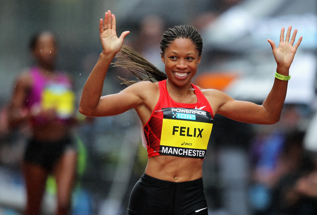 MANCHESTER, ENGLAND - MAY 15:  Allyson Felix of USA celebrates her 200m race win Myriam Soumarie of France, Christine Ohuruogu of Great Britain and Joice Maduaka of Great Britain during the Powerade Great City Games on May 15, 2011 in Manchester, England.