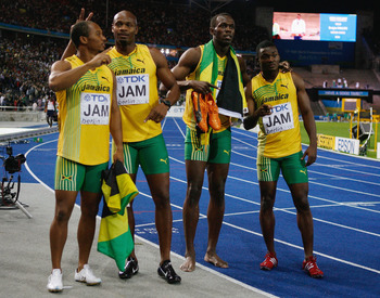 BERLIN - AUGUST 22:  (L-R) Michael Frater, Asafa Powell, Usain Bolt and Steve Mullings celebrate winning the gold medal in the mens 4x100 Metres Relay Final with mascot Berlino during day eight of the 12th IAAF World Athletics Championships at the Olympic
