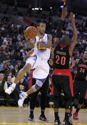 OAKLAND, CA - MARCH 25:  Monta Ellis #8 of the Golden State Warriors in action against the Toronto Raptors at Oracle Arena on March 25, 2011 in Oakland, California. NOTE TO USER: User expressly acknowledges and agrees that, by downloading and or using thi