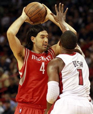 MIAMI, FL - MARCH 27:  Forward Chris Bosh #1 of the Miami Heat defends against Forward Luis Scola #4 of the Houston Rockets at American Airlines Arena on March 27, 2011 in Miami, Florida. NOTE TO USER: User expressly acknowledges and agrees that, by downl