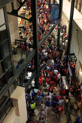 ARLINGTON, TX - MAY 24:  MLB fans walk around the concourse during a rain delay at Rangers Ballpark in Arlington on May 24, 2011 in Arlington, Texas.  (Photo by Ronald Martinez/Getty Images)
