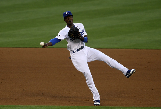 LOS ANGELES, CA - JUNE 20:  Shortstop Dee Gordon #9 of the Los Angeles Dodgers throws out Danny Worth of the Detroit Tigers in the third inning on June 20, 2011 at Dodger Stadium in Los Angeles, California.   (Photo by Stephen Dunn/Getty Images)