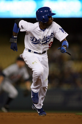 LOS ANGELES, CA - JUNE 21:  Dee Gordon #9 of the Los Angeles Dodgers runs to third base against the Detroit Tiger in the sixth inning of the game at Dodger Stadium on June 21, 2011 in Los Angeles, California.  (Photo by Jeff Golden/Getty Images)