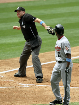 LOS ANGELES, CA - JUNE 19:  Michael Bourn #21 of the Houston Astros is ejected from the game by home plate umpire Jeff Nelson after arguing a called third strike in the fifth inning of the game with the Los Angeles Dodgers on June 19, 2011 at Dodger Stadi