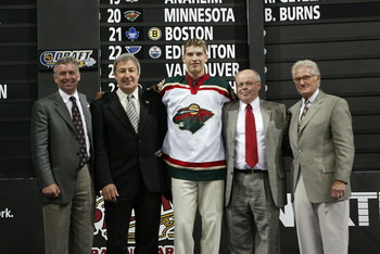 NASHVILLE, TN - JUNE 21:  (L to R) Doug Risebrough, Guy Lapointe, first round draft pick (#20 overall) Brent Burns, Tom Thompson and Bob Naegele Jr. of the Minnesota Wild pose for a portrait on stage during the 2003 NHL Entry Draft at the Gaylord Entertai
