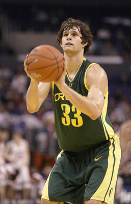 LOS ANGELES - MARCH 12:  Luke Jackson #33 of the Oregon Ducks shoots a free throw against the Stanford Cardinal in the Semifinals of the 2004 Pacific Life Pac-10 Tournament at Staples Center on March 12, 2004 in Los Angeles, California.  Stanford won 70-6