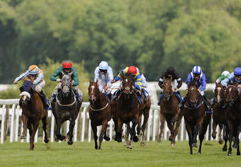 SALISBURY, ENGLAND - JUNE 22: David Probert riding Whiplash Willie (L) win The Ashbrittle Stud Bibury Cup Stakes at Salisbury racecourse on June 22, 2011 in Salisbury, England  (Photo by Alan Crowhurst/ Getty Images)
