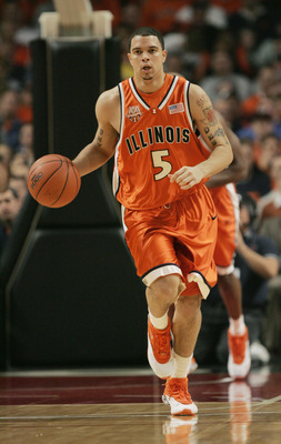 CHICAGO - DECEMBER 11:  Deron Williams #5 of the University of Illinois Fighting Illini drives against the University of Oregon Ducks during the game on December 11, 2004 at the United Center in Chicago, Illinois. Illinois defeated Oregon 83-66. (Photo by