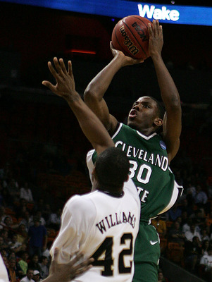 MIAMI - MARCH 20:  Guard Norris Cole #30 (R) of the Cleveland State University Vikings takes a shot over  guard L.D. Williams #42 (L) of Wake Forest Demon Deacons during the first round of the NCAA Division I Men's Basketball Tournament at the American Ai