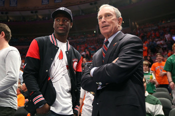 NEW YORK, NY - APRIL 24:  NBA draft prospect Kemba Walker from the University of Connecticut Huskies and New York City Mayor Michael Bloomberg watch the New York Knicks play against the Boston Celtics in Game Four of the Eastern Conference Quarterfinals d