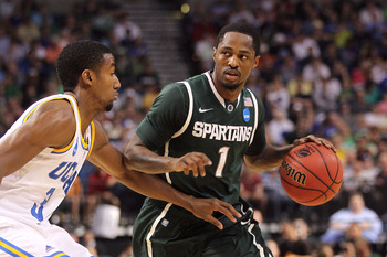 TAMPA, FL - MARCH 17:  Kalin Lucas #1 of the Michigan State Spartans drives against the UCLA Bruins during the second round of the 2011 NCAA men's basketball tournament at St. Pete Times Forum on March 17, 2011 in Tampa, Florida.  (Photo by Mike Ehrmann/G