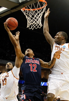 TULSA, OK - MARCH 20:  Lamont Jones #12 of the Arizona Wildcats goes up for a shot against Tristan Thompson #13 and Jordan Hamilton #3 of the Texas Longhorns during the third round of the 2011 NCAA men's basketball tournament at BOK Center on March 20, 20