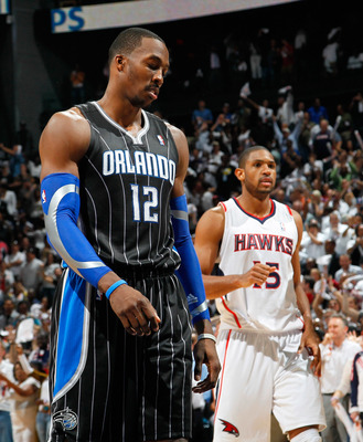 ATLANTA, GA - APRIL 28:  Dwight Howard #12 of the Orlando Magic reacts after a turnover to the Atlanta Hawks during Game Six of the Eastern Conference Quarterfinals in the 2011 NBA Playoffs at Philips Arena on April 28, 2011 in Atlanta, Georgia.  NOTE TO