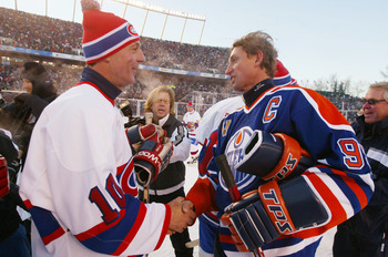 EDMONTON, CANADA - NOVEMBER 22:  Wayne Gretzky (R), Guy Lafleur (L) shakes hands after the Edmonton Oilers faced the Montreal Canadiens during the Molson Canadien Heritage Classic Megastars Game on November 22, 2003 at Commonwealth Stadium in Edmonton, Ca