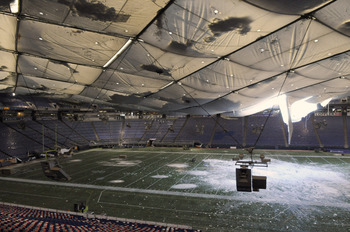 MINNEAPOLIS, MN - DECEMBER 13: A torn section of the roof sags inside the Hubert H. Humphrey Metrodome on December 13, 2010 in Minneapolis, Minnesota. The Metrodome's roof collapsed under the weight of snow after a powerful blizzard hit the area on Decemb