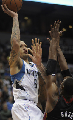 MINNEAPOLIS, MN - APRIL 1: Michael Beasley #8 of Minnesota Timberwolves shoots against Chris Bosh #1 of the Miami Heat during the second half of a basketball game at Target Center on April 1, 2011 in Minneapolis, Minnesota. The Heat defeated the Timberwol