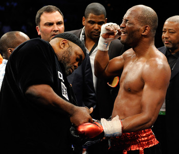 LAS VEGAS - APRIL 03:  Bernard Hopkins (R) reacts as his trainer Naazim Richardson takes his gloves off after Hopkins defeated Roy Jones Jr. in their light heavyweight bout by unanimous decision at the Mandalay Bay Events Center April 3, 2010 in Las Vegas