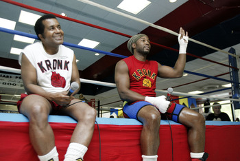 SCOTRUN, PA MAY 29:  Lennox Lewis and his trainer Emanuel Steward speak to the media about his upcoming championship bout at his training camp on May 29, 2003 in Scotrun, Pennsylvania. Lewis is training for is upcoming WBC title defense against Kirk Johns