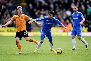 WOLVERHAMPTON, ENGLAND - FEBRUARY 20:  Kevin Doyle of Wolverhampton and Paulo Ferreira of Chelsea battle for the ball during the Barclays Premier League match between Wolverhampton Wanderers and Chelsea at Molineux on February 20, 2010 in Wolverhampton, E