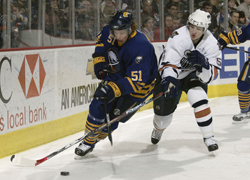 BUFFALO, NY - FEBRUARY 15:  Brian Campbell #51 of the Buffalo Sabres looks to control the puck as Ladislav Smid #5 of the Edmonton Oilers defends the play during their NHL game on February 15, 2007 at HSBC Arena in Buffalo, New York.  The Sabres defeated