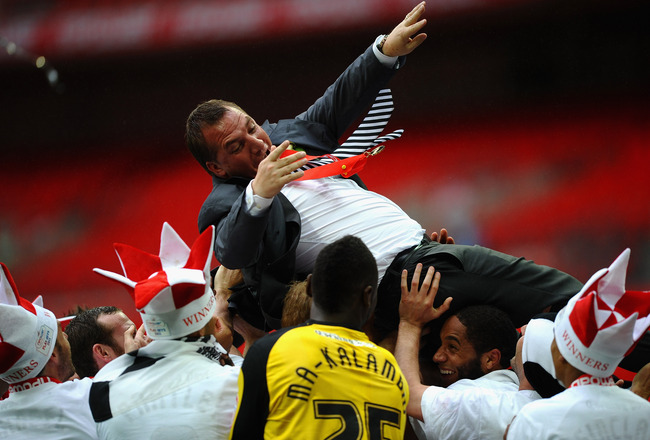 LONDON, ENGLAND - MAY 30:  Brendan Rogers of Swansea City is thrown in the air by his players after victory in the npower Championship Playoff Final between Reading and Swansea City at Wembley Stadium on May 30, 2011 in London, England.  (Photo by Laurenc