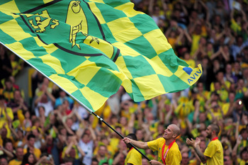 NORWICH, ENGLAND - MAY 07:  Marc Tierney of Norwich City waves the flag during the npower Championship match between Norwich City and Coventry City at Carrow Road on May 7, 2011 in Norwich, England.  (Photo by Jamie McDonald/Getty Images)