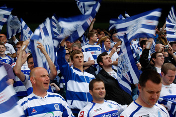 LONDON, ENGLAND - MAY 07:  QPR fans wave flags before the npower Championship match between Queens Park Rangers and Leeds United at Loftus Road on May 7, 2011 in London, England.  (Photo by Dan Istitene/Getty Images)
