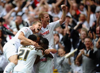 LONDON, ENGLAND - MAY 30: Scott Sinclair of Swansea is mobbed after scoring his third goal with Fabio Borini during the npower Championship Playoff Final between Reading and Swansea City at Wembley Stadium on May 30, 2011 in London, England.  (Photo by La