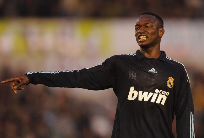SANTANDER, SPAIN - APRIL 04:  Mahamadou Diarra  of Real Madrid points during the La Liga match between Racing Santander and Real Madrid at El Sardinero stadium on April 4, 2010 in Santander, Spain.  (Photo by Denis Doyle/Getty Images)