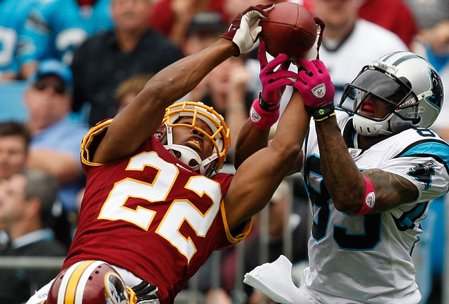 CHARLOTTE, NC - OCTOBER 11:  Steve Smith #89 of the Carolina Panthers has a pass broken up by Carlos Rogers #22 of the Washington Redskins at Bank of America Stadium on October 11, 2009 in Charlotte, North Carolina.  (Photo by Streeter Lecka/Getty Images)