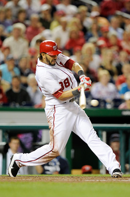 WASHINGTON, DC - JUNE 14: Michael Morse #38 of the Washington Nationals drives in a run with a groundout in the seventh inning against the St. Louis Cardinals at Nationals Park on June 14, 2011 in Washington, DC. The Nationals won the game 8-6. (Photo by