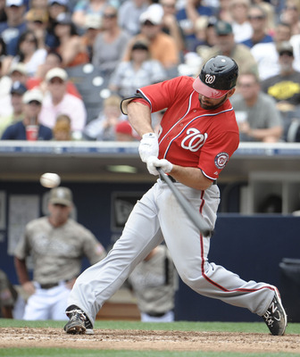 SAN DIEGO, CA - JUNE 12: Danny Espinosa #18 of the Washington Nationals hits a sacrifice fly during the ninth inning of a baseball game against the San Diego Padres at Petco Park on June 12, 2011 in San Diego, California. The Nationals won 2-0.  (Photo by