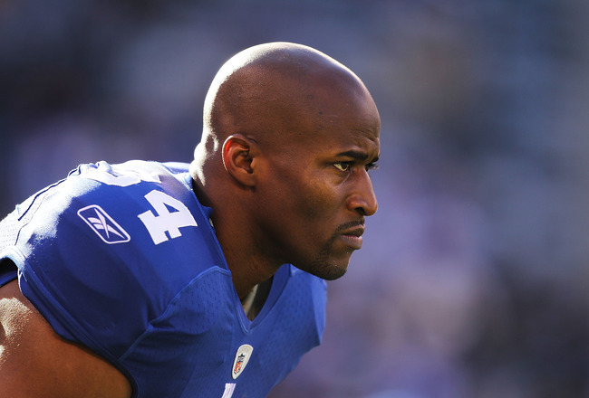 EAST RUTHERFORD, NJ - NOVEMBER 28: Deon Grant #34 of the New York Giants looks on before the game against the Jacksonville Jaguars during their game on November 28, 2010 at The New Meadowlands Stadium in East Rutherford, New Jersey.  (Photo by Al Bello/Ge