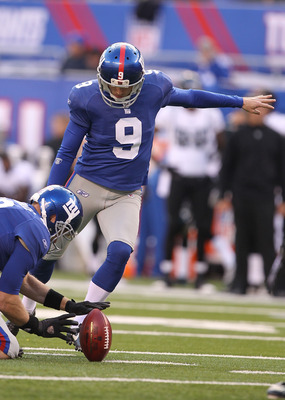 EAST RUTHERFORD, NJ - NOVEMBER 28:  Lawrence Tynes #9 of the New York Giants kicks the ball as Sage Rosenfels #18 holds against the Jacksonville Jaguars during their game on November 28, 2010 at The New Meadowlands Stadium in East Rutherford, New Jersey.