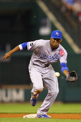 ST. LOUIS, MO - JUNE 17: Alcides Escobar #2 of the Kansas City Royals fields a ground ball against the St. Louis Cardinals at Busch Stadium on June 17, 2011 in St. Louis, Missouri.  (Photo by Dilip Vishwanat/Getty Images)