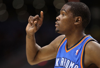 PHOENIX, AZ - MARCH 30:  Kevin Durant #35 of the Oklahoma City Thunder in action during the NBA game against the Phoenix Suns at US Airways Center on March 30, 2011 in Phoenix, Arizona. The Thunder defeated the Suns 116-98.   NOTE TO USER: User expressly