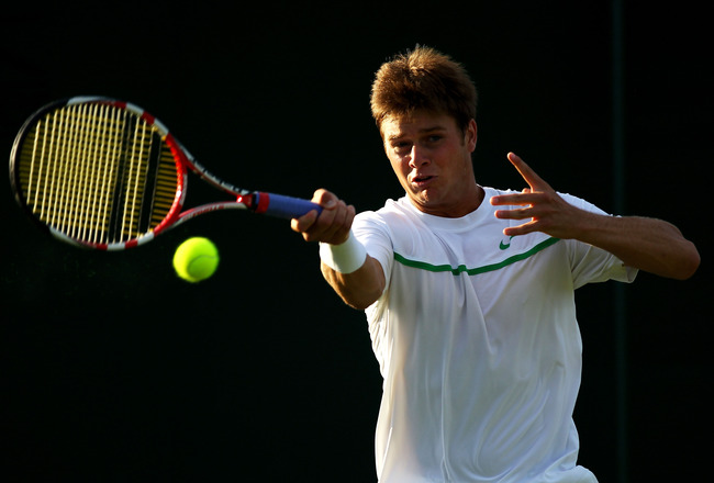 LONDON, ENGLAND - JUNE 21:  Ryan Harrison of the United States returns a shot during his first round match against Ivan Dodig of Croatia on Day Two of the Wimbledon Lawn Tennis Championships at the All England Lawn Tennis and Croquet Club on June 21, 2011