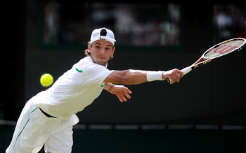 LONDON, ENGLAND - JUNE 23:  Grigor Dimitrov of Bulgaria lines up a shot during his second round match against Jo-Wilfried Tsonga of France on Day Four of the Wimbledon Lawn Tennis Championships at the All England Lawn Tennis and Croquet Club on June 23, 2