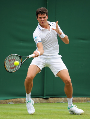 LONDON, ENGLAND - JUNE 20:  Milos Raonic of Canada returns a shot during his first round match against Fabio Fognini of Italy on Day One of the Wimbledon Lawn Tennis Championships at the All England Lawn Tennis and Croquet Club on June 20, 2011 in London,