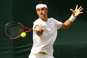 LONDON, ENGLAND - JUNE 21:  Bernard Tomic of Australia returns a shot during his first round match against Nikolay Davydenko of Russia on Day Two of the Wimbledon Lawn Tennis Championships at the All England Lawn Tennis and Croquet Club on June 21, 2011 i