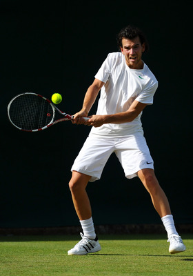 LONDON, ENGLAND - JUNE 21:  Adrian Mannarino of France returns a shot during his first round match against Conor Niland of Ireland on Day Two of the Wimbledon Lawn Tennis Championships at the All England Lawn Tennis and Croquet Club on June 21, 2011 in Lo