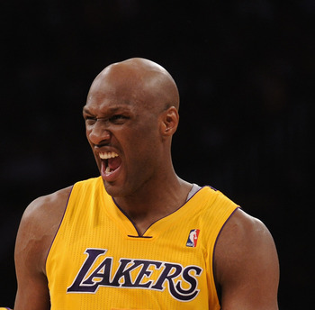 LOS ANGELES, CA - MARCH 31:  Lamar Odom #7 of the Los Angeles Lakers reacts after his third consecutive three pointer with Steve Blake #5 during a 110-82 win over the Dallas Mavericks at Staples Center on March 31, 2011 in Los Angeles, California.  NOTE T