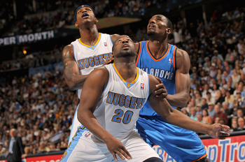 DENVER, CO - APRIL 23:  Raymond Felton #20, Al Harrington #7 of the Denver Nuggets and Serge Ibaka #9 of the Oklahoma City Thunder battle for rebounding position in Game Three of the Western Conference Quarterfinals in the 2011 NBA Playoffs on April 23, 2