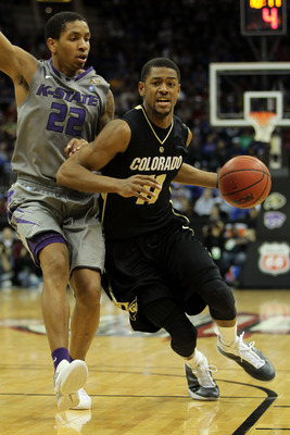 KANSAS CITY, MO - MARCH 10:  Cory Higgins #11 of the Colorado Buffaloes drives with the ball against Rodney McGruder #22 of the Kansas State Wildcats during their quarterfinal game in the 2011 Phillips 66 Big 12 Men's Basketball Tournament at Sprint Cente